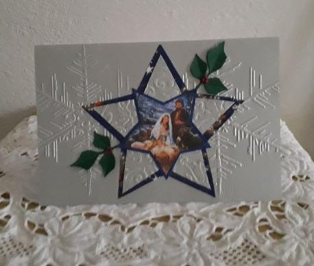 biglietto natalizio stella con natività